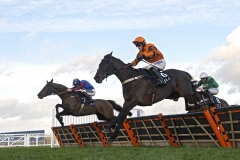 PAISLEY PARK (LEFT) JUMPS THE LAST FLIGHT BEHIND WEST APPROACH (ORANGE) AND TOP NOTCH (RIGHT) ON WAY TO WINNING THE LONG WALK HURDLE.ASCOT 21-12-18.Photo © George Selwyn +44 (0)7967 030722116 Wellington Parade Kent UK CT14 8AF.