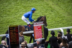 ADAM KIRBY TAKES HARRY ANGEL TO POST DOWN THE STAND RAIL IN FRONT OF THE BOOKIES DISPLAYING THE ODDS FOR THE GOLEN JUBILEE STAKES.ASCOT 23-6-18.Photo © George Selwyn +44 (0)7967 030722116 Wellington Parade Kent UK CT14 8AF.
